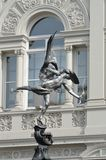 Eros statue with arch Stock Photo