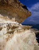 Erosion. Eroded limestone cliff face in northern Cyprus stock photo