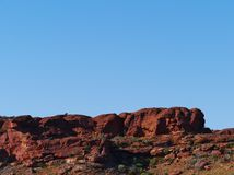 Erosion of the Australian red rocks. View of the sandstone rocks opposite a blue sky at Kings Canyon in the Watarrka National Park in Northern Territory in Stock Photography