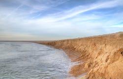 Erosion av sand Arkivbild