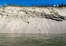 Erosion on cutbank of Yukon River in Canada Royalty Free Stock Image