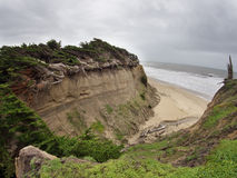 Erosion is happening fast. Large chunks of land lost to the sea. Stock Photos