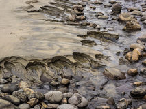 Erosion patterns in the sand Royalty Free Stock Photo