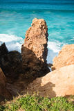 Erosion red soil cliffs rocks on atlantic coast in beautiful turquoise water Stock Images