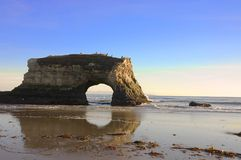 Erosion by the sea. A natural archway created by the erosion of the sea stock photo