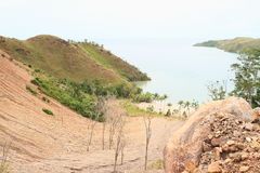 Erosion. On slope hill to bay between green hills - Papua Barat, Indonesia Stock Photo