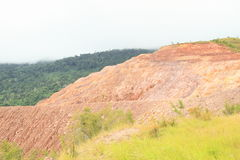 Erosion. Of soil on stone slope of hill on mountain with construction of new road - geological minerals Stock Image
