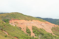 Erosion. Of soil on stone slope of hill on mountain with construction of new road - geological minerals stock photo