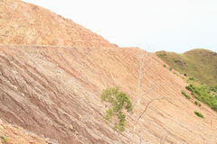 Erosion. Of soil on stone slope of hill on mountain with construction of new road - geological minerals royalty free stock photos