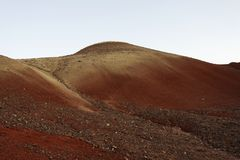 Erosion of soils in a high desert landscape. Erosion of red soils in a high desert landscape. Painted hills land formations - Central Oregon USA stock photo