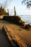 Erosion, wave destroy seawall, effect of climate change Stock Image