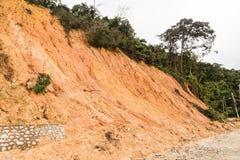 Erosione del pendio con il crollo della terra al pendio nel environme tropicale Immagine Stock Libera da Diritti