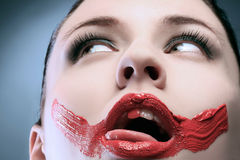 Erotic. An erotic portrait of a lady with paint on face Royalty Free Stock Photo