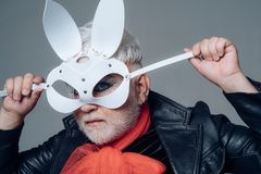Erotic bunny. Transgender man cover face with rabbit mask. Animal roleplayer. BDSM fashion accessory. Adult sex toys. Male makeup look. Fetish fashion royalty free stock photo