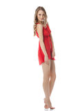 Erotic fashion. Pretty model in red negligee Stock Photos