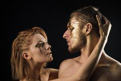 Erotic games of couple in love. couple with golden body art makeup isolated on black. Golden collagen mask and. Beauty. 24K Gold. Gold spa and skincare stock photos