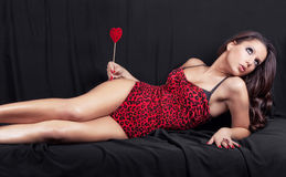 Erotic girl lying on the bed Royalty Free Stock Image
