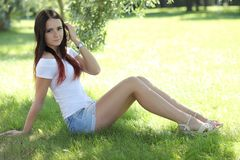 Free Erotic Girl With Mini Skirt On Green Grass Stock Image - 104538201