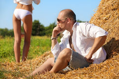 Erotic scene on hayloft Stock Photography