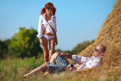 Erotic scene on hayloft Stock Image