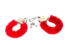 Erotic red hand cuffs. Erotic Sex toy as red hand cuffs  over white background stock photo