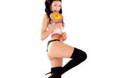 Erotic smiling woman in bikini with big candy Royalty Free Stock Image
