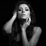 Erotic woman looking hot with long brown hair. Black and white portrait Royalty Free Stock Photography
