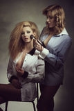 Erotic women applying make-up Stock Photos