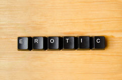 Erotic word. With keyboard buttons Royalty Free Stock Images