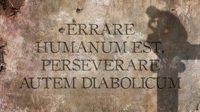 Errare humanum est, perseverare autem diabolicum. A Latin phrase. Errare humanum est, perseverare autem diabolicum. A Latin phrase that MEANS To err is human Stock Photo