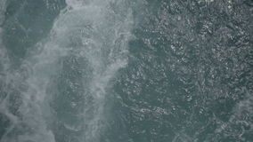Erratic Slow Motion Water. Medium wide high angle high dynamic range slow motion shot of erratic turbulent sea water waves stock video footage