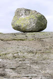 Erratic stone on the granite rock. Stock Photo