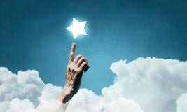 Erreichen Sie und berühren Sie den Stern Gemischte Medien Lizenzfreie Stockfotos