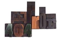 Erreur 404 écrite dans le type blocs d'impression typographique Photographie stock