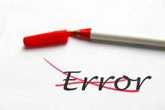 Error fix. Error crossed out with red ink, on white paper Stock Image