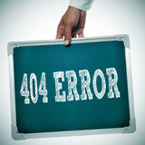 404 error. Hand holding a chalkboard with the message 404 error written in it stock image