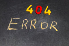 404 error - message handwritten with white chalk on chalkboard Royalty Free Stock Photos