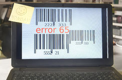 Error message on a laptop. With monday smile stock photos