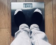 Error message on scales. Standing on the bathroom scales and getting an error message stock images