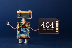 404 error page not found concept. Creative design robot with warning text message on memory card. Blue background. 404 error page not found concept. Creative royalty free stock photo