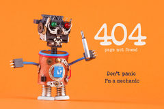 404 error page not found concept. Don`t panic I`m a mechanic. Robotic handyman with screw driver. macro view, orange Stock Photography