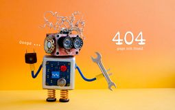 Error 404 page not found concept. Friendly crazy robot handyman with hand wrench on yellow orange background royalty free stock photos