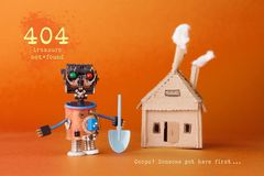 404 error page not found concept. Robot treasure hunter with a shovel near a cardboard toy house. Text Treasure not. Found. Ooops someone got here first. Orange Stock Images