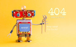 Error 404 page not found concept. IT specialist steampunk machinery robot, smiley red head, blue monitor body, pliers. Keep calm I`ll fix it message on yellow Royalty Free Stock Photos