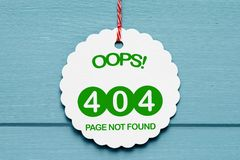 404 error. 404 page not found error message illustrated on white ornament against painted blue boards royalty free stock photos