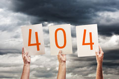 404 error, page not found. Hands holding paper wiyh printed numbers royalty free stock photo