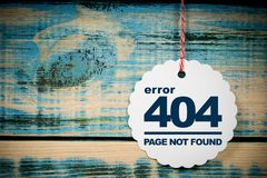 Error 404 page not found. A 404 page not found error on white label on wooden background royalty free stock images