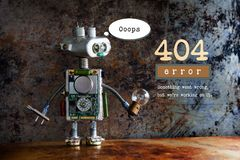 404 error page not found. Robot handyman with driver and light bulb on aged metalic background. Text message Royalty Free Stock Photo