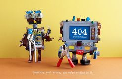 404 error page not found. Serviceman robots with pliers on yellow brown orange background. Text message Something went Stock Photo