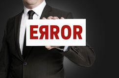 Error sign held by businessman Royalty Free Stock Photography